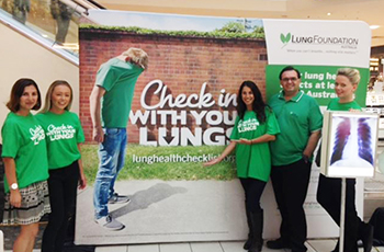 charity cups donation partners lung foundation in front of sign