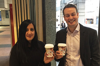 corporate professionals holding guardian early learning advertised coffee cups